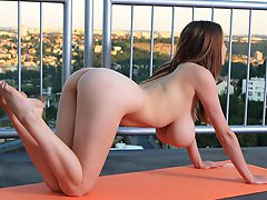 Naked huge boobed girl doing yoga outdoors