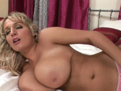 Busty Jannete playing with her huge mellons in the bedroom