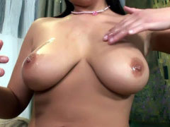 Busty babe Beatrice oils up her large, soft boobs and pussy