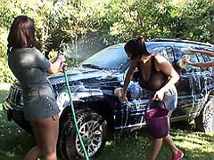 Playful busty lesbians washing car & each other