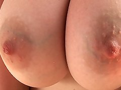 Hot Ricky playing with her sexy big tits outdoors