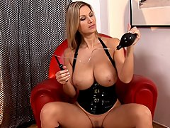 Latex babe Carol and her toy