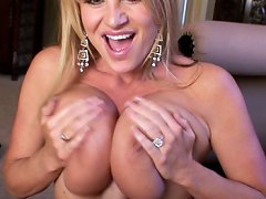 Kelly beats on her tits with a cock and titty fucks your cock with her huge soft boobs.