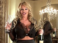 Kelly rings in the New Year in black lingerie and masturbates while looking in a mirror.