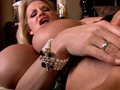 Kelly gardens in a sheer tank then pulls a pearl necklace from her pussy in black thigh highs and finishes with a peach lingerie and titty squeezing.