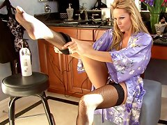 Kelly gets out of her silky robe to put her out fit on and gets distracted when she finds her favorite vibrator.