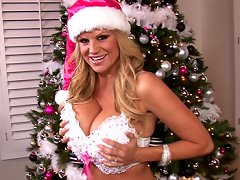Kelly's ready for X-mas, she has her pink hat on and white sparkly bra on which she quickly takes off after she gets a new toy.