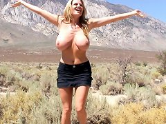Kelly exposes her gigantic natural boobs on a nature walk and finds a guy to fuck outdoors.
