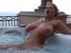 Kelly gets off when the jets in the Jacuzzi hit her clit. She jumps out of the water and needs the real thing to finish her off.