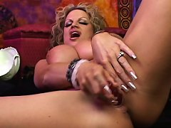 Psychic Kelly is having an orgasm and sucking her pussy juice off her dildo.