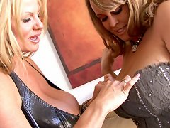 Brandy has her huge naturals trapped in a tight corset and Kelly takes them out to play with.