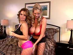 Kelly and Sienna wear pink, black and red lingerie and fishnets while they bump and rub their tits together and taste each other's pussies.